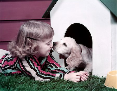 dog kissing girl - 1970s GIRL PUPPY KISS DOG HOUSE Stock Photo - Rights-Managed, Code: 846-03164139