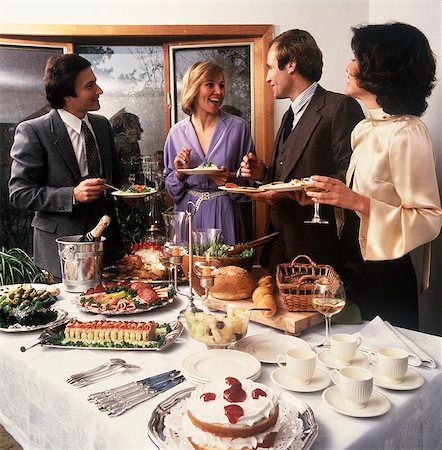 1970s TWO COUPLES SOCIALIZING AT PARTY BUFFET TABLE Stock Photo - Rights-Managed, Code: 846-03164261