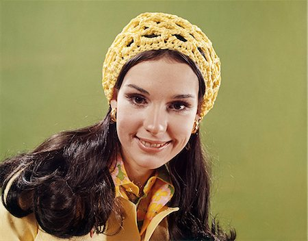 1970s PORTRAIT SMILING YOUNG LONG HAIR BRUNETTE WOMAN WEARING YELLOW CROCHET CAP Stock Photo - Rights-Managed, Code: 846-03164545