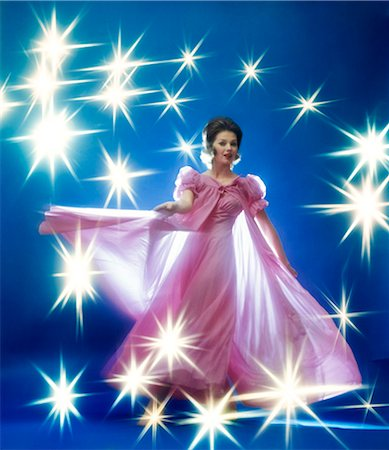 effect - 1960s 1970s WOMAN BRUNETTE IN ROSE GOWN DANCING YELLOW STARS SPECIAL EFFECT Stock Photo - Rights-Managed, Code: 846-03164548