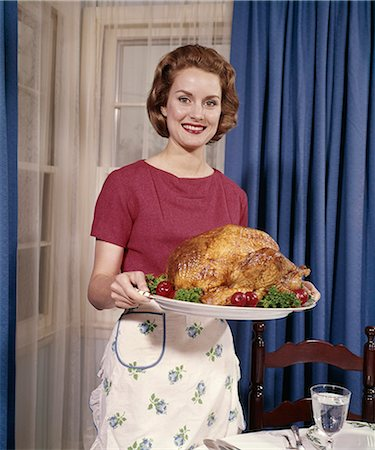 1960s SMILING WOMAN SERVING THANKSGIVING TURKEY DINNER Stock Photo - Rights-Managed, Code: 846-03164603