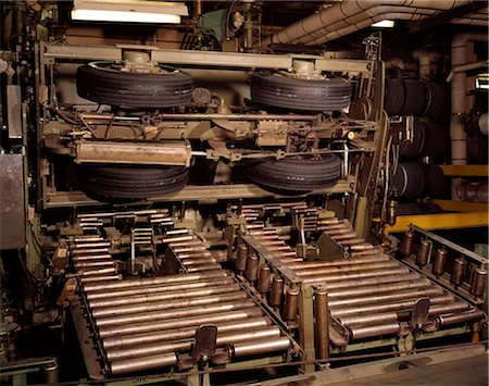 1960s AUTOMOBILE TIRES ON FACTORY ASSEMBLY LINE Stock Photo - Rights-Managed, Code: 846-03164703