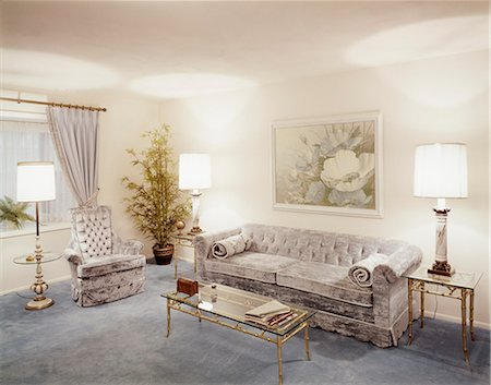 1970s LIVING ROOM WITH PALE BLUE VELVET COUCH ARMCHAIR AND GLASS COFFEE & END TABLES Stock Photo - Rights-Managed, Code: 846-03164734