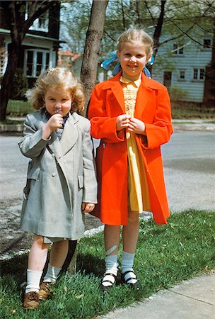 1950s TWO LITTLE GIRLS WEARING SPRING COATS OUTDOORS Stock Photo - Rights-Managed, Code: 846-03164806