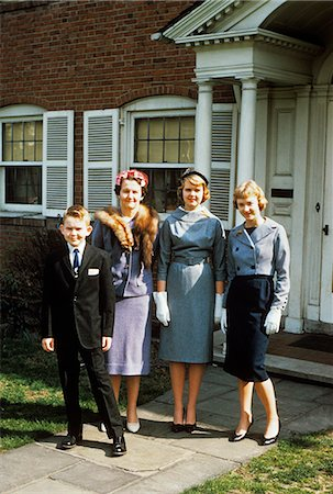 1950s MOTHER WITH TEENAGE GIRLS & YOUNGER SON DRESSED UP POSING IN FRONT OF HOUSE Stock Photo - Rights-Managed, Code: 846-03164800