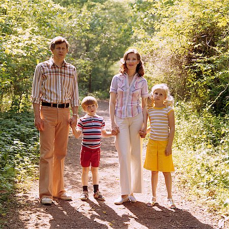 1970s FAMILY WALKING OUTDOORS FULL LENGTH MOTHER FATHER TWO KIDS MAN WOMAN BOY GIRL SUMMER Stock Photo - Rights-Managed, Code: 846-03164861