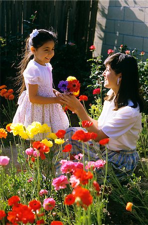 MOTHER IN GARDEN WITH DAUGHTER Stock Photo - Rights-Managed, Code: 846-03164871