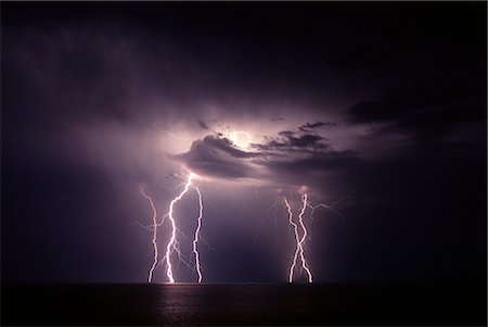 LIGHTNING STORM AT NIGHT OVER WATER Stock Photo - Rights-Managed, Code: 846-03164892