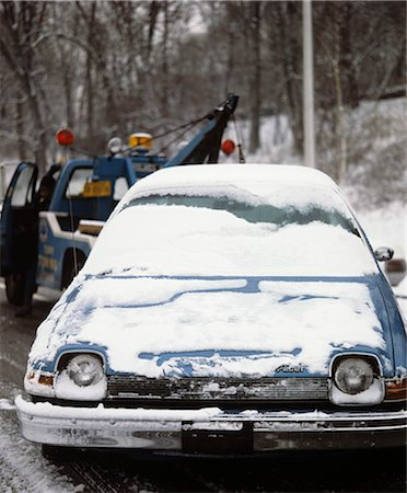 1970s CAR COVERED WITH LIGHT SNOW BEING TOWED BY TOW TRUCK Stock Photo - Rights-Managed, Code: 846-03165032