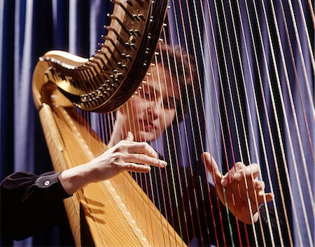 1960s WOMAN PLAYING HARP PLUCKING STRINGS Stock Photo - Rights-Managed, Code: 846-03165054