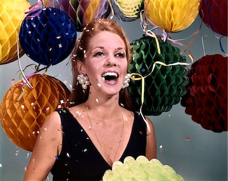 1960s LAUGHING WOMAN BIG PEARL EARRINGS WITH BALLOONS AND FALLING CONFETTI AND STREAMERS Stock Photo - Rights-Managed, Code: 846-03165082