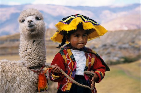 south - CUZCO, PERU QUECHUA INDIAN GIRL WITH BABY LLAMA Stock Photo - Rights-Managed, Code: 846-03165462