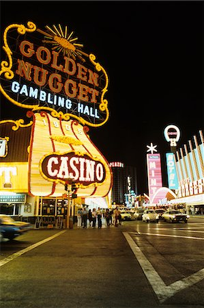 1970s FREMONT STREET DOWNTOWN LAS VEGAS NEVADA AT NIGHT WITH NEON OF GOLDEN NUGGET HORSESHOE AND MINT CASINOS Stock Photo - Rights-Managed, Code: 846-03165587