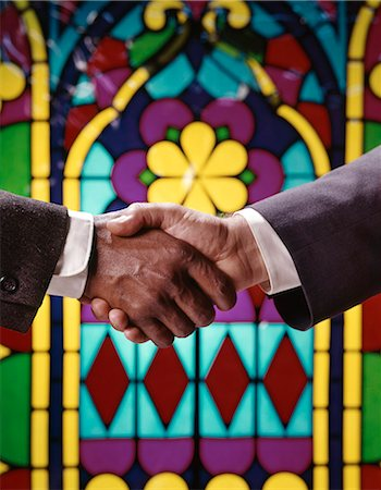 1960s AFRICAN AMERICAN AND CAUCASIAN MALE HANDSHAKE IN FRONT OF STAINED GLASS WINDOW Stock Photo - Rights-Managed, Code: 846-03165699