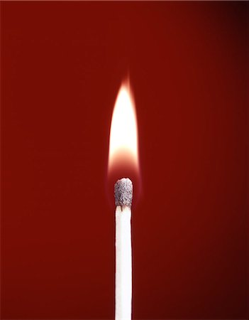 BURNING WOODEN SAFETY MATCH ON RED BACKGROUND FLAME Stock Photo - Rights-Managed, Code: 846-03165799