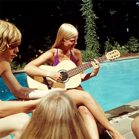 1970s TEEN GIRL PLAYING GUITAR SWIMMING POOL PARTY Stock Photo - Rights-Managed, Code: 846-03165791