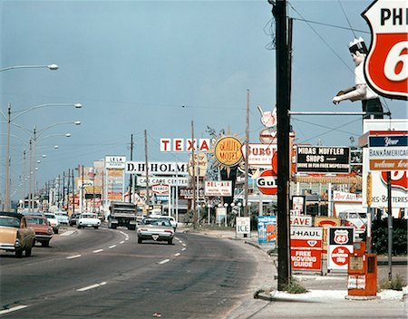 1960s SIGNS ALONG CHEF MENTEUR HIGHWAY NEW ORLEANS LA SUBURBAN SHOPS FAST FOOD MOTELS GAS BUSY CLUTTER AMERICANA Stock Photo - Rights-Managed, Code: 846-03166093