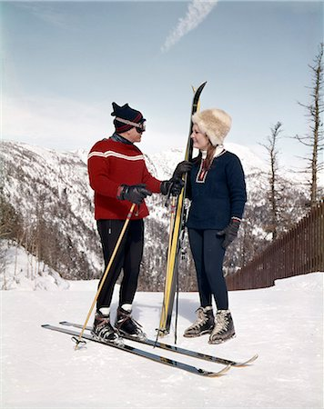 1960s SMILING COUPLE TALKING ON SKI SLOPE WEARING SKI GEAR Stock Photo - Rights-Managed, Code: 846-03166174