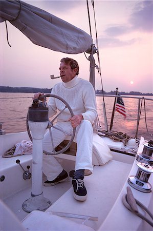 1980s CHESAPEAKE BAY MARYLAND MAN IN WHITE AT WHEEL OF SAILING BOAT Stock Photo - Rights-Managed, Code: 846-03166236