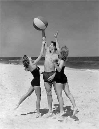 1950s TEENS JUMPING FOR BEACH BALL WEARING SWIM SUITS Stock Photo - Rights-Managed, Code: 846-03163191