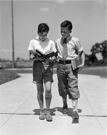 1930s TWO BOYS WALKING SCHOOL READING BOOKS Stock Photo - Rights-Managed, Code: 846-03163229