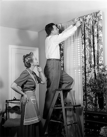 1950s HUSBAND WIFE CURTAINS APRON Stock Photo - Rights-Managed, Code: 846-03163338