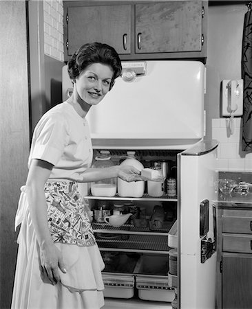 1950s WOMAN REFRIGERATOR ICEBOX KITCHEN HOUSEWIFE Stock Photo - Rights-Managed, Code: 846-03163345