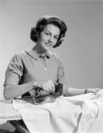 1950s WOMAN HOUSEWIFE IRONING Stock Photo - Rights-Managed, Code: 846-03163341