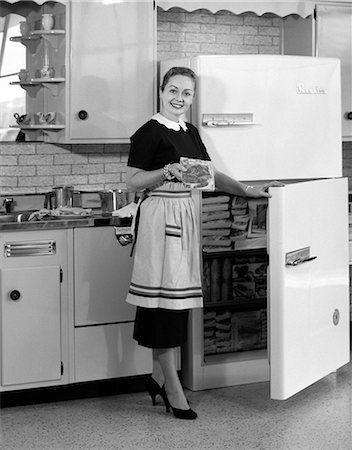 1950s WOMAN KITCHEN REFRIGERATOR Stock Photo - Rights-Managed, Code: 846-03163354