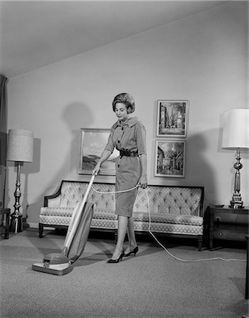 1960s WOMAN VACUUM HOUSEWORK CHORE HOUSEWIFE Stock Photo - Rights-Managed, Code: 846-03163358