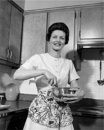 1960s WOMAN KITCHEN HOUSEWIFE STIR Stock Photo - Rights-Managed, Code: 846-03163351