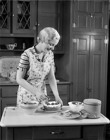 photos of 1940s women in kitchen - 1940s WOMAN BAKING PIE KITCHEN Stock Photo - Rights-Managed, Code: 846-03163362