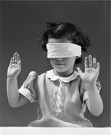 1940s CHILD WEARING BLIND FOLD WITH HANDS IN THE AIR Stock Photo - Rights-Managed, Code: 846-03163402