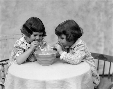1930s TWO GIRLS PLAYING WITH PIPES SMOKE Stock Photo - Rights-Managed, Code: 846-03163423