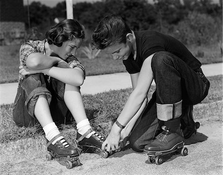 roller skate - 1950s BOY AND GIRL PUTTING ON ROLLER-SKATES SITTING ON SIDEWALK Stock Photo - Rights-Managed, Code: 846-03163436
