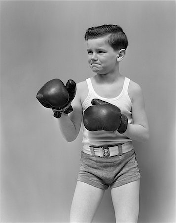1940s CHILD WEARING BOXING GLOVES STANDING Stock Photo - Rights-Managed, Code: 846-03163440