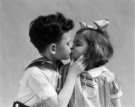 1940s TWO CHILDREN KISSING Stock Photo - Rights-Managed, Code: 846-03163469