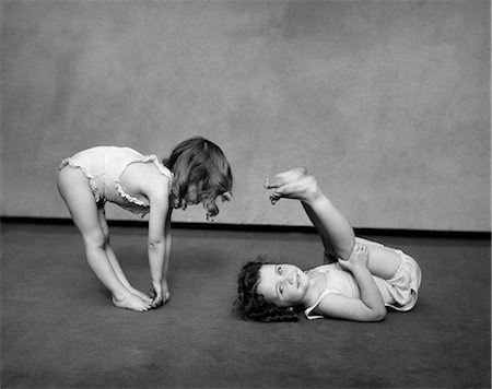 1930s TWO GIRLS WEARING UNDERCLOTHES PLAYING AT EXERCISING Stock Photo - Rights-Managed, Code: 846-03163500
