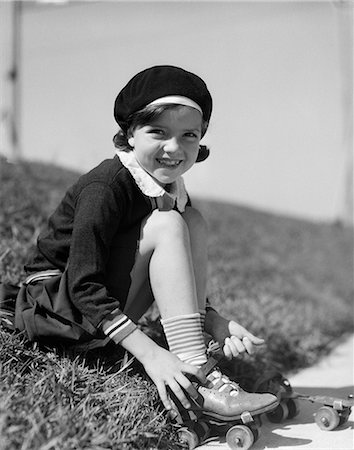 roller skate - 1930s CHILD PUTTING ON ROLLER-SKATE SITTING Stock Photo - Rights-Managed, Code: 846-03163535