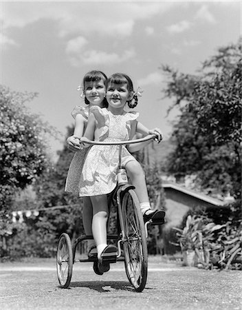 1940s TWIN GIRLS RIDING OUTSIDE ON TRICYCLE Stock Photo - Rights-Managed, Code: 846-03163547