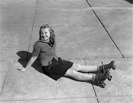 roller skate - 1940s CHILD SITTING ON GROUND WEARING ROLLER-SKATES Stock Photo - Rights-Managed, Code: 846-03163559