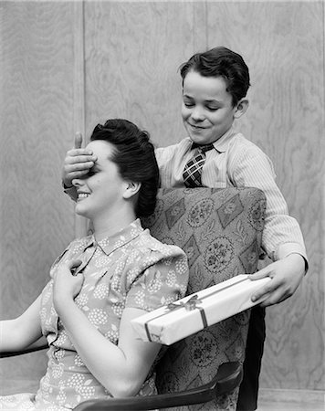 1940s BOY SON SURPRISE PRESENT CHAIR ADULT FEMALE Stock Photo - Rights-Managed, Code: 846-03163565