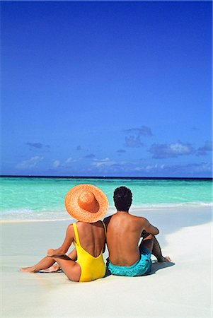 sandi model - 1990s MAN AND WOMAN SITTING ON THE BEACH FACING THE WATER MOPION ISLAND, GRENADINES, WEST INDIES Stock Photo - Rights-Managed, Code: 846-03163782