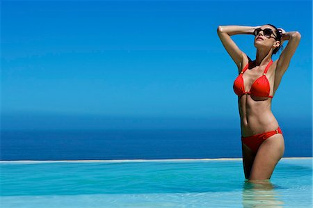 Beautiful brunette in swimming pool Stock Photo - Rights-Managed, Code: 847-04929205