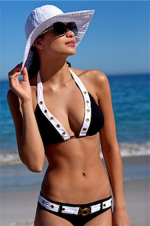 Beautiful brunette on the beach Stock Photo - Rights-Managed, Code: 847-04929207