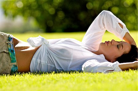 Beautiful brunette girl lying on the grass Stock Photo - Rights-Managed, Code: 847-04929937