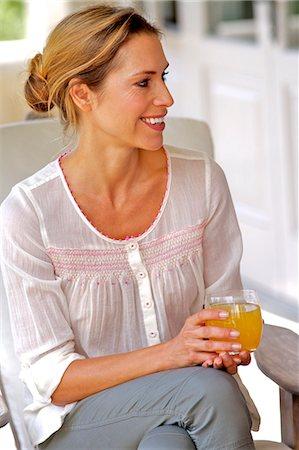 Mature woman drinking orange juice Stock Photo - Rights-Managed, Code: 847-05606877