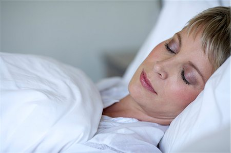 Mature short haired woman asleep in bed Stock Photo - Rights-Managed, Code: 847-05606975