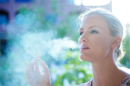 Landscape image of a woman smoking a cigarette Stock Photo - Rights-Managed, Code: 847-05607034