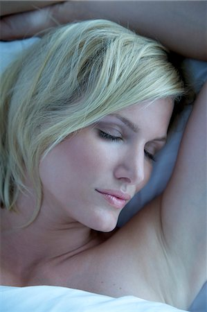 Portrait of a blonde woman asleep in bed Stock Photo - Rights-Managed, Code: 847-05607038